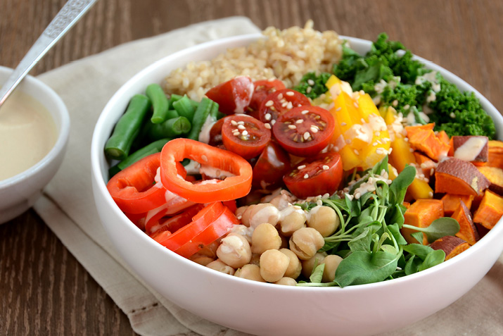 Buddha-style bowl with veggies, brown rice and tahini dressing
