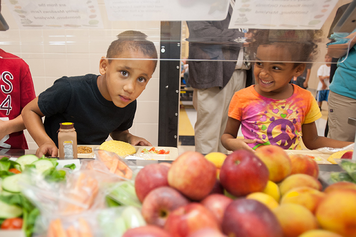 Food Co-ops Dig in to Support Farm to School Programs - Child in Maryland Cafeteria