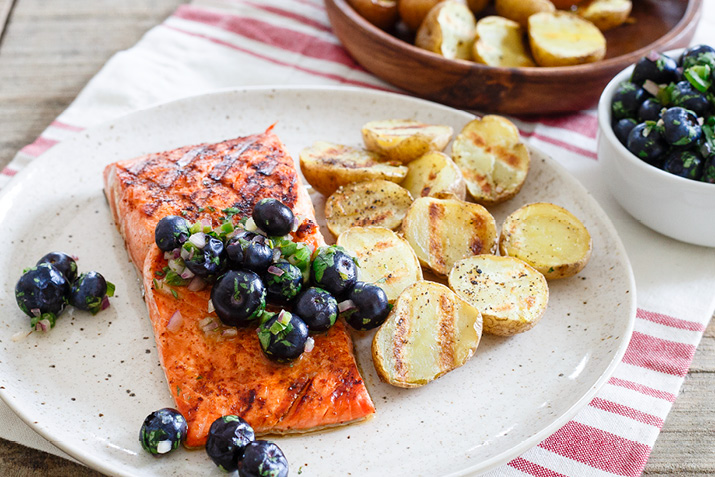 Grilled salmon topped with blueberry salsa