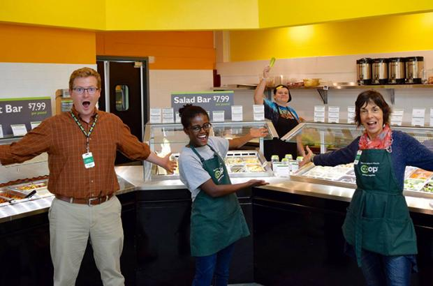 Four enthusiastic employees at a food co-op. Co-op Values and Principles