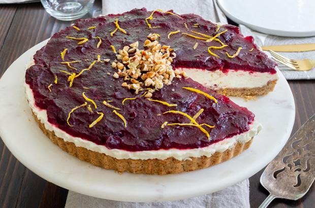 Chevre mousse tart with a pecan crust topped with cranberries