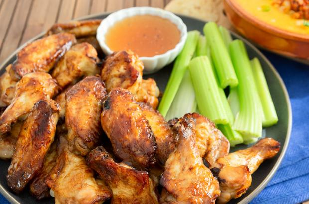 Chicken wings on a plate with celery sticks
