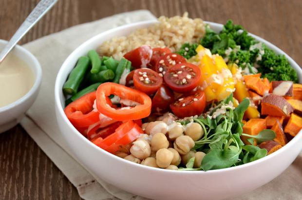 Buddha-style bowl with veggies, brown rice and tahini dressing