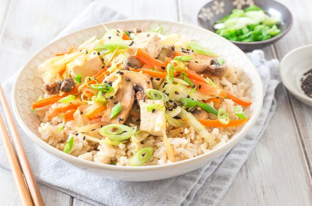 Bowl of brown rice with egg roll toppings