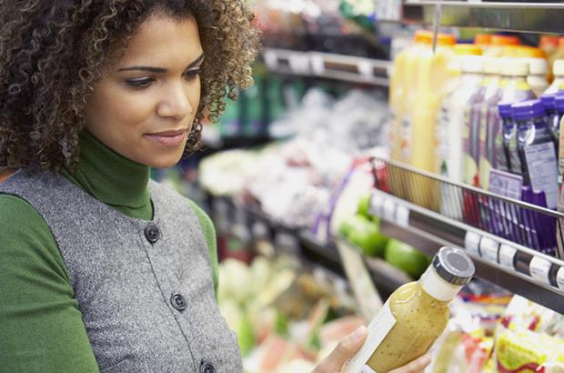Woman examining product for GMOs