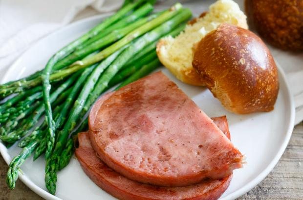 Honey-Bourbon Glazed Ham Steaks with a side of asparagus