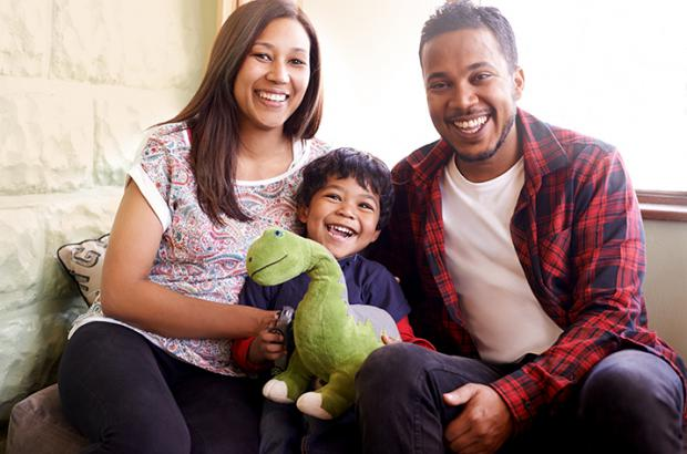 Smiling couple with child