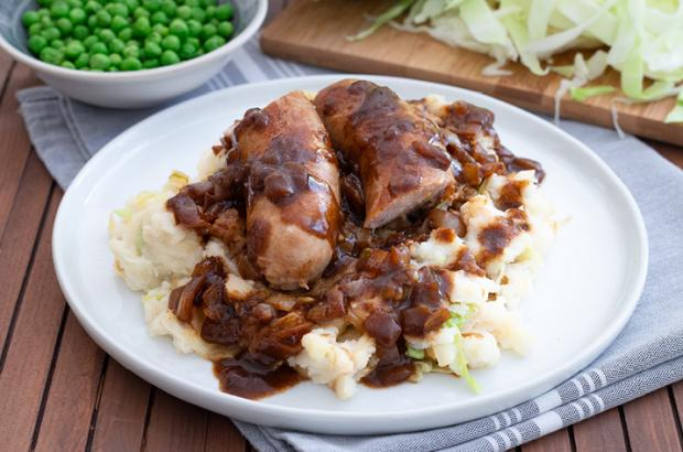 Irish Bangers and Mash - sausages with onion gravy and mashed potatoes with cabbage