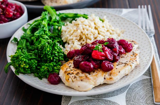 Plate of Maple Cranberry Chicken with sides of broccolini and rice