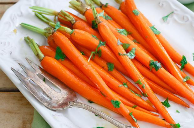 Platter of whole maple glazed carrots with green tops