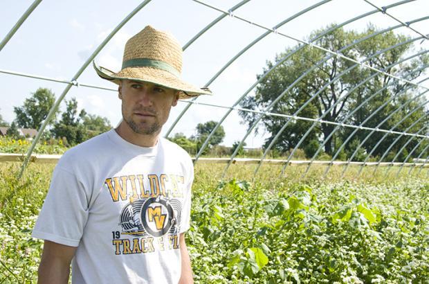 Organic farmer in hoop house
