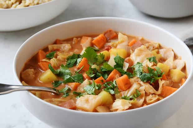 Bowl of sweet potato, peanut, cabbage, African stew