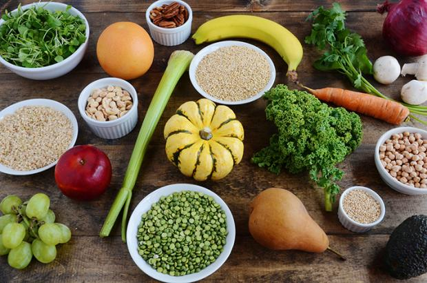 Variety of fruits, veggies, grains and beans on a table