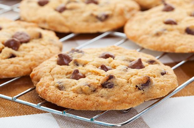 Homemade chocolate chip cookies on a cookie rack