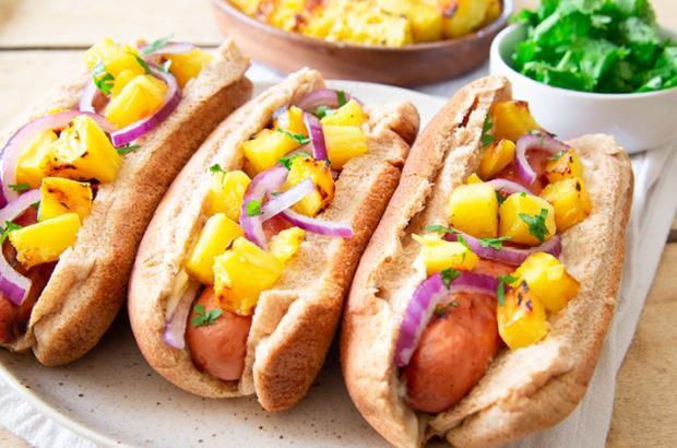 Hot dogs with pineapple, wasabi mayo, jalapenos
