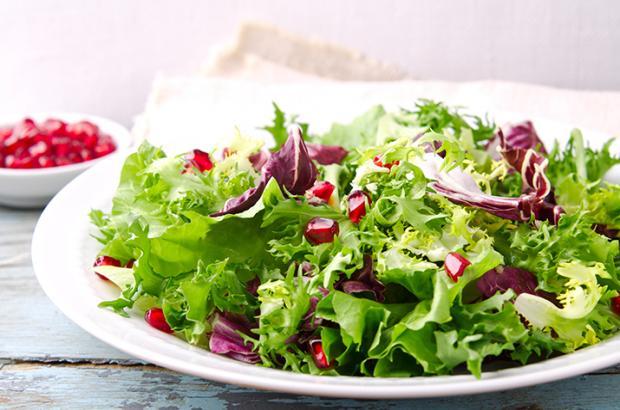 Salad with different lettuce varieties:  frisee, arugula, radicchio