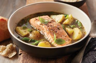Bowl of Roasted Salmon and Vegetables in Pesto Broth