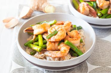 Bowl of Ginger Shrimp and Asparagus Stir-Fry on brown rice
