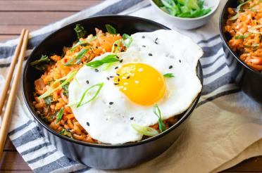 Bowl of Kimchi Fried Rice with a fired egg on top