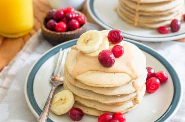 Stack of peanut butter pancakes with peanut butter syrup