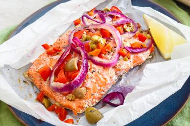 Salmon and veggies on parchment paper