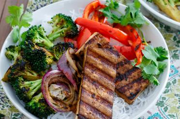Smoky grilled tofu and broccoli atop noodles