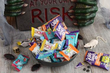 Bowl of candy that's includes organic, fair trade and non-GMO ingredients