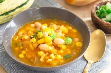 Bowl of corn, squash and bean soup - Three Sisters Soup