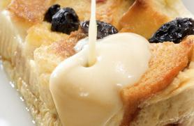 Blueberry Peach Bread Pudding with White Chocolate Sauce