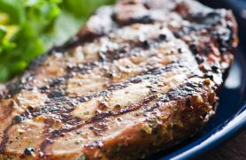 Grilled Pork Chops with Blueberry Barbecue Sauce