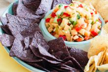 Chips and bowl of Cantaloupe Salsa