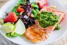 Chipotle-Lime Grilled Arctic Char on a plate with a side salad