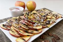 Apple slices drizzled with a chocolate-raspberry syrup