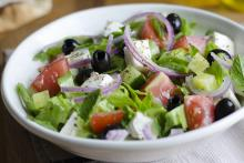 Classic chopped salad with lettuce, olives, tomatoes, feta, red onions