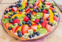 Shortbread fruit pizza topped with colorful sliced fruit