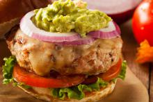 Turkey burger with cheese and guacamole