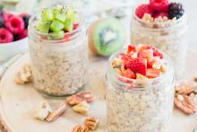 Overnight Oats with Almond Butter and Fruit in jars topped with fresh fruit