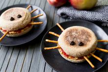 """Peanut Butter and Jelly """"Spiders"""" made with English Muffins, pretzel stick legs and chocolate chip eyes"""