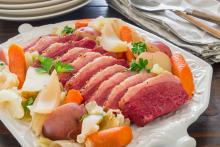 Platter with sliced corned beef and cabbage