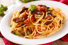 Pasta topped with Sun-Dried Tomato Puttanesca Sauce